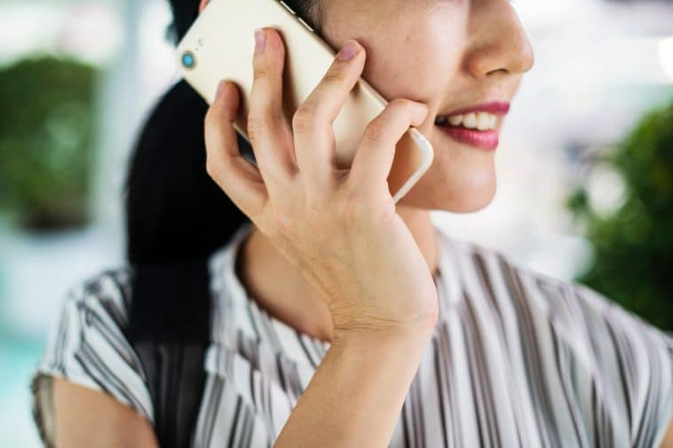 A close up of a woman talking on the phone